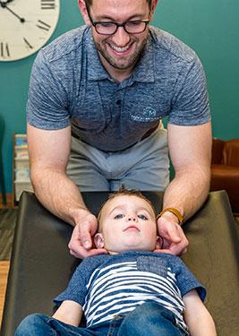 Chiropractor Fargo ND Fargo Seth Lunneborg with Child